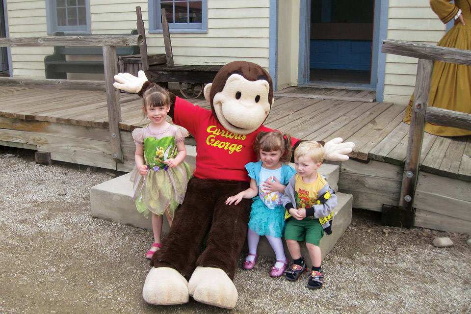 spring-arts-preview-storybook-village-curious-george