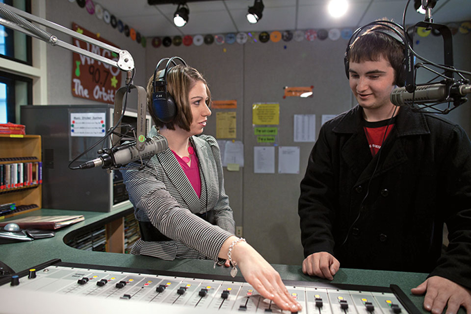 Lisa Marshall in the studio with a student