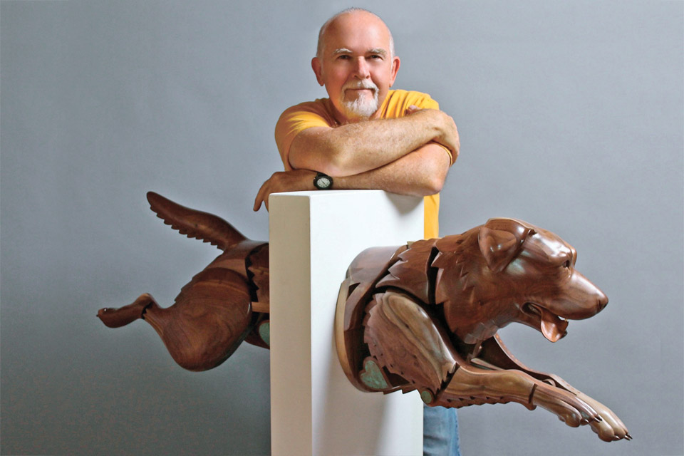 Artist James Mellick and one of his works