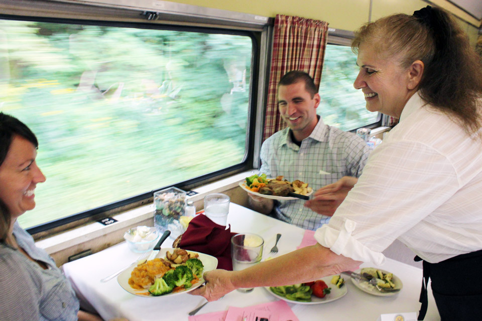 Guests enjoy a dinner train excursion