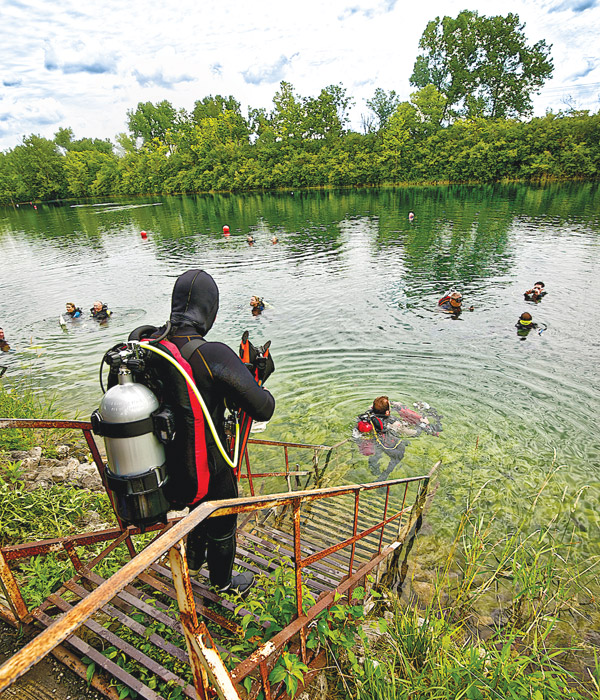 Quarry divers entering water