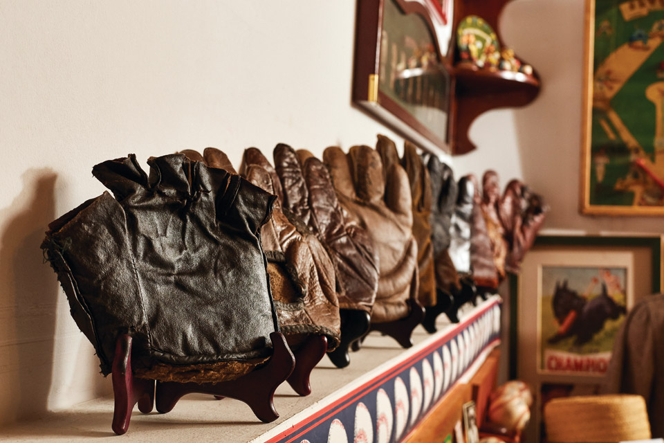 display of vintage baseball gloves