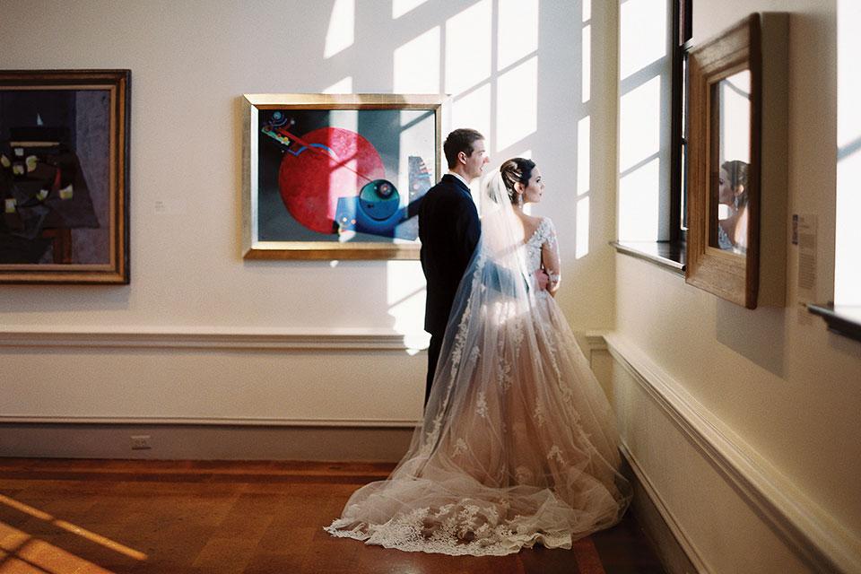 Wertz Wedding Dayton Art Institute Bride and Groom Amongst Exhibits (photo by Jenny Haas Photography)