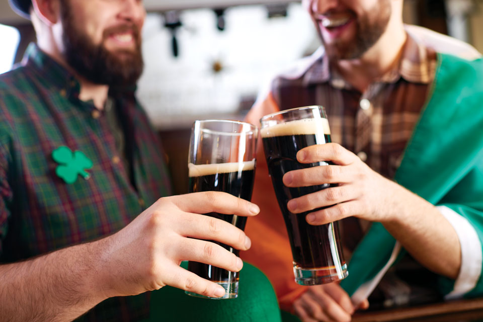 Two men in Irish attire giving a cheers (photo courtesy of iStock)