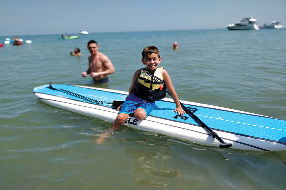 Child on North Coast Outpost paddleboard