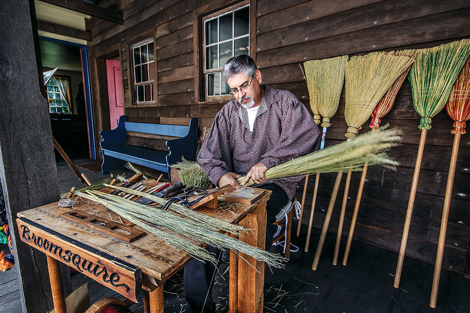 Man working at Zoar Village (photo by Andy Donaldson)