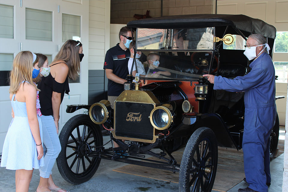Willie Harman explaining the features of a 1914 Model T