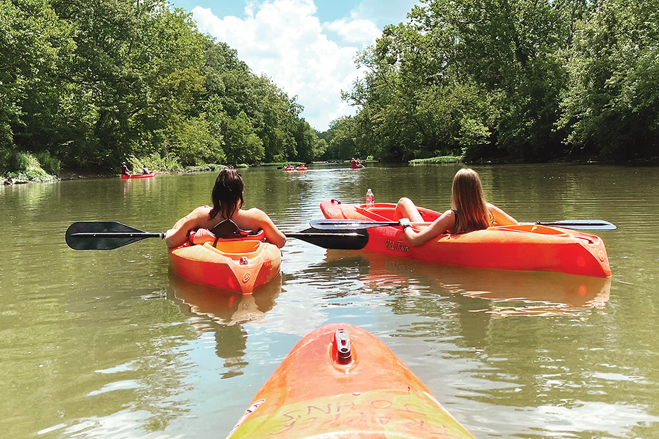 Two women in kayaks (photo by Madison Farley)