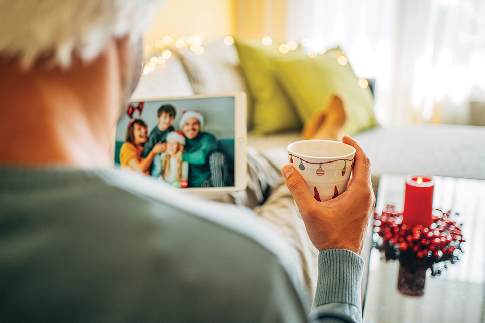 Man looking at family holiday photo (photo by iStock)