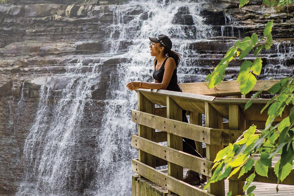Woman looking at Brandywine Falls (photo by Laura Watilo Blake)