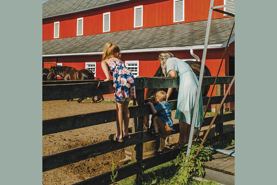 Slate Run Living Historical Farm kids looking at horses