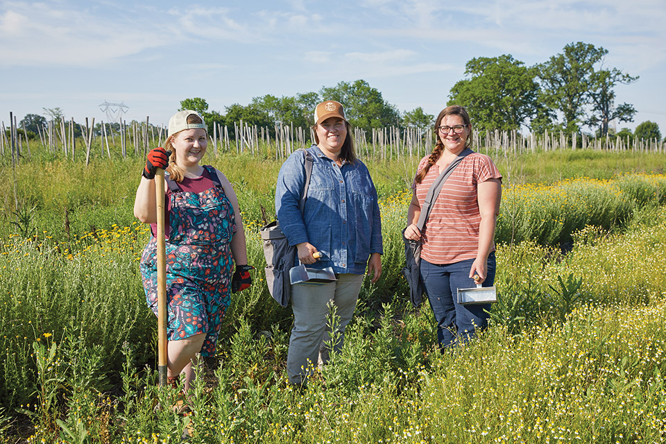 Holly DeLong, Kate Hodges and Jane Larson in a field