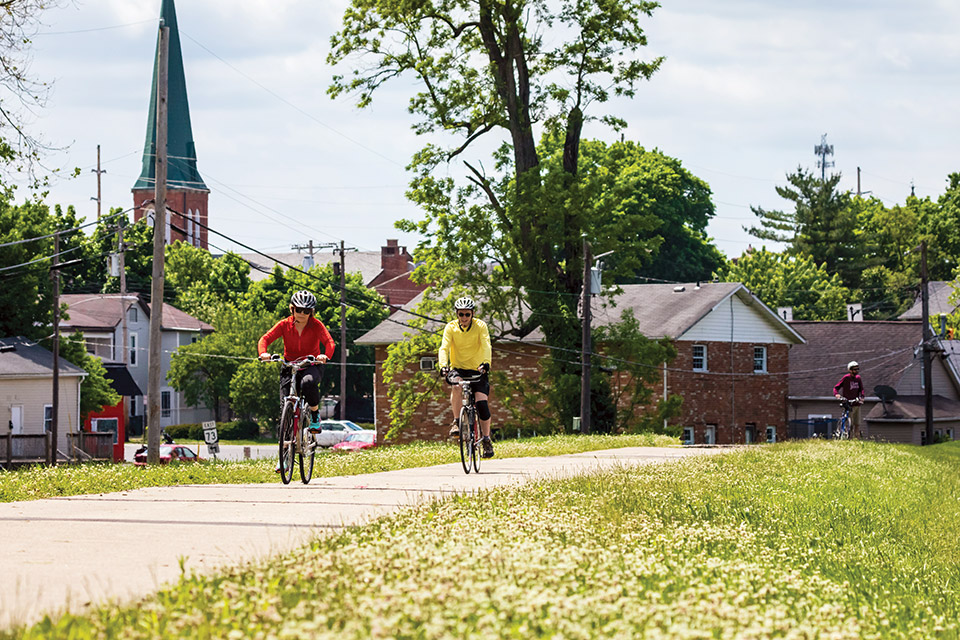 Two people cycling in Franklin (photo by Andy Snow)