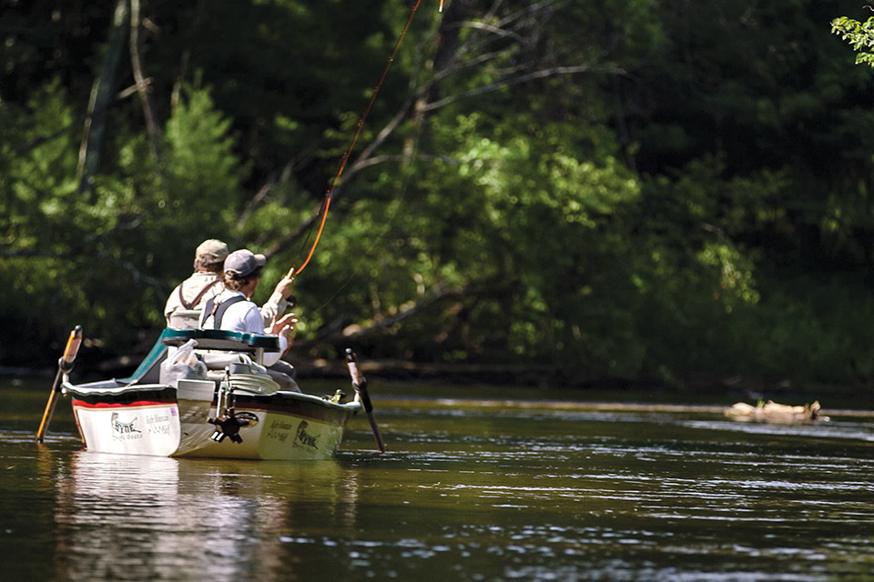 People fly fishing on the Pere Marquette (photo courtesy of Pure Ludington)