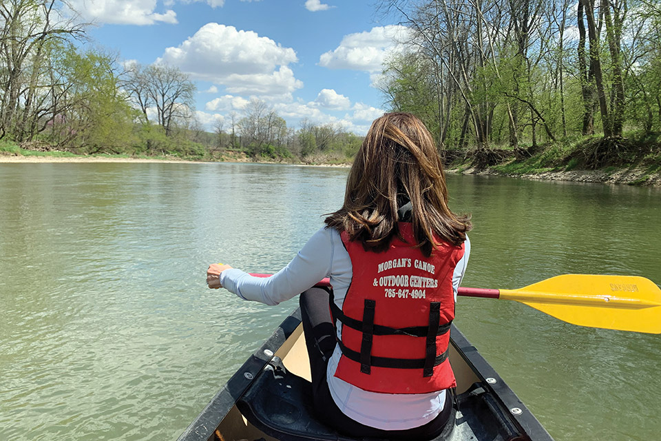 Woman canoeing on the Little Miami River (courtesy of Morgan's Canoe & Outdoor Adventures)