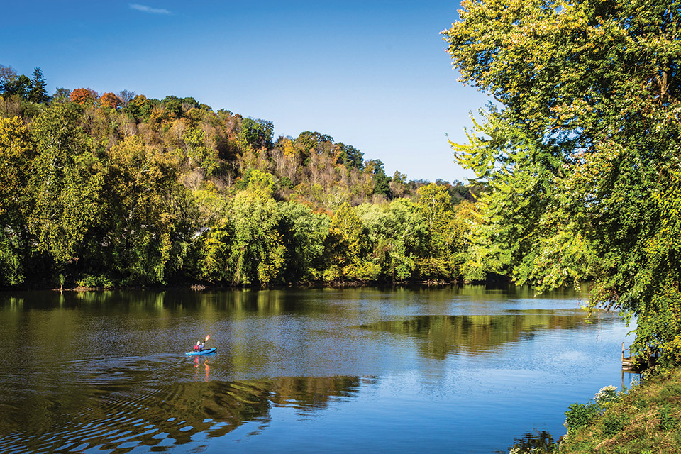 Person paddling on the Muskingum River (photo by Laura Watilo Blake)