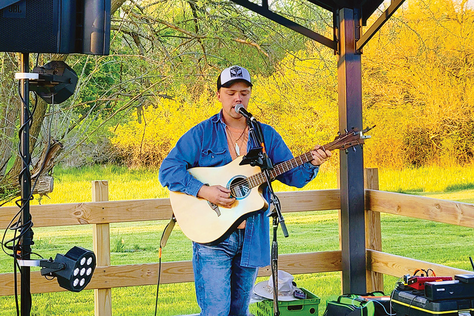 Musician performing at Twenty One Barrels Cidery and Winery (photo courtesy of Twenty One Barrels Cidery and Winery)