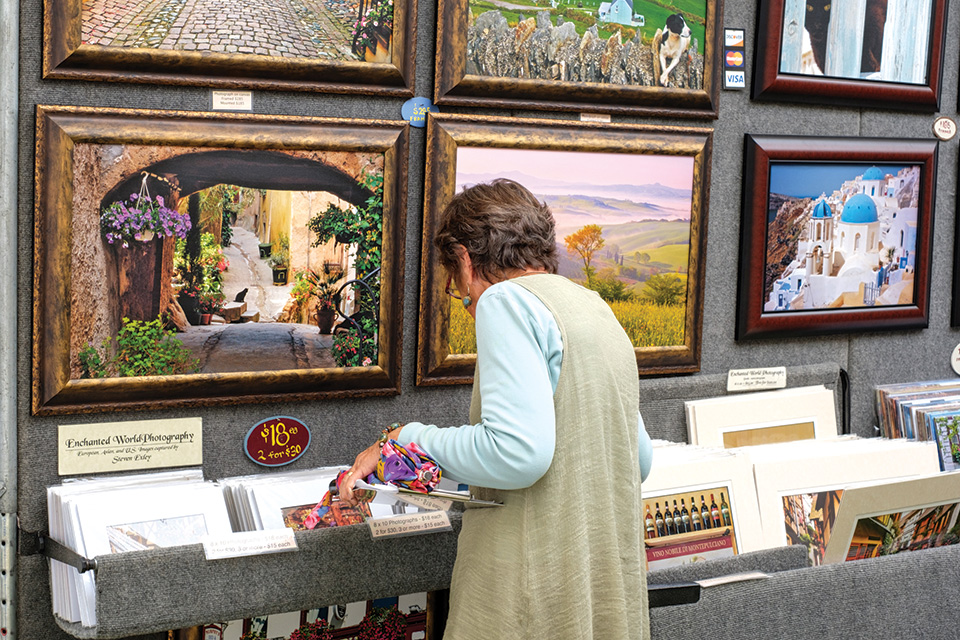 Woman looking at art (photo courtesy of Crosby Festival of the Arts)