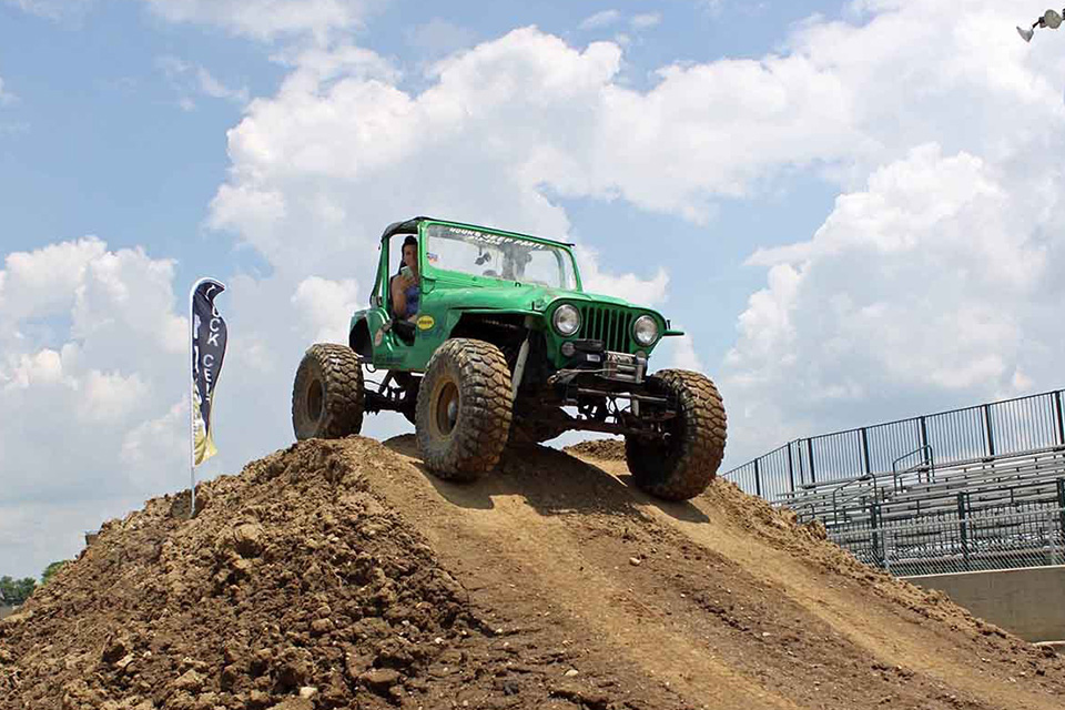 Jeep on dirt mound (photo courtesy of Jeep Fest)