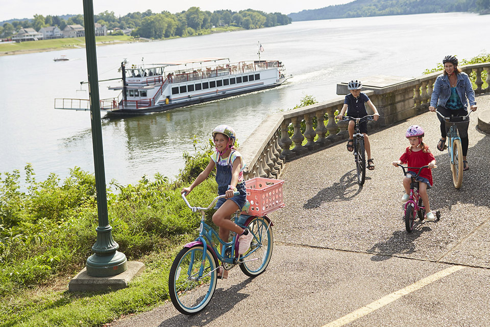 Family biking by the Valley Gem sternwheeler (photo by Casey Rearick)