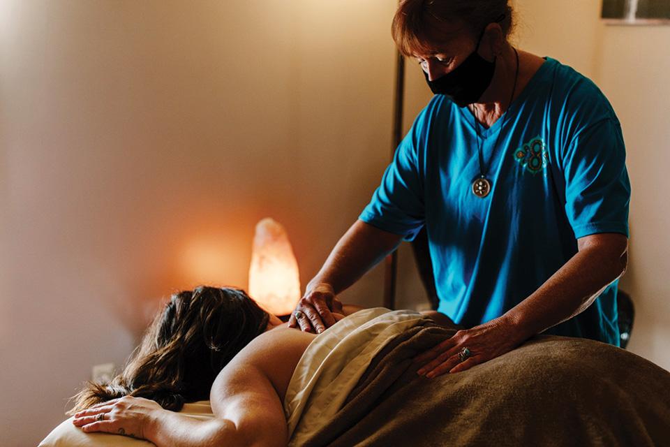 Woman getting a massage at Inner Wisdom Wellness (photo by Megan Leigh Barnard)
