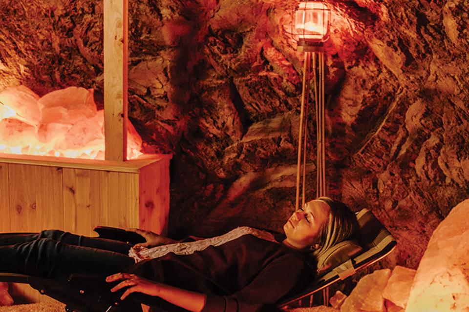 Woman relaxing in Hocking Hills Serenity Cave (photo by Megan Leigh Barnard)