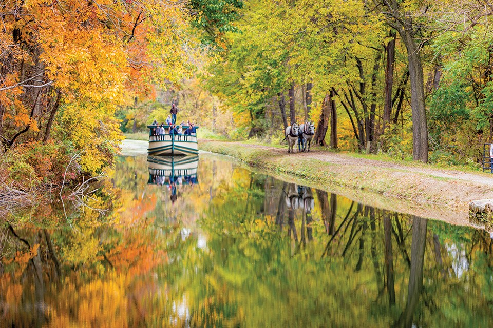 Historic Roscoe Village boat on the water in fall (courtesy of Visit Coshocton)